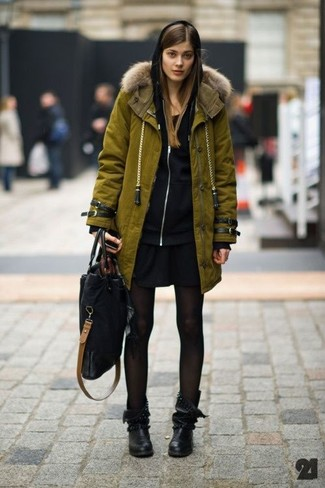 How to wear: black leather mid-calf boots, black casual dress, black hoodie, olive parka