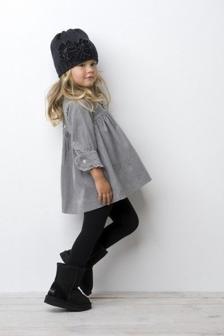 Girls' Looks & Outfits: What To Wear In 2020: Teach your mini fashionista how to look put-together and stylish by dressing her in grey dress. Black uggs are a smart choice to finish off this look.