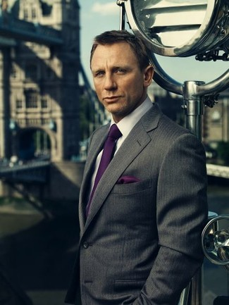 Daniel Craig wearing Charcoal Vertical Striped Blazer, White Dress Shirt, Dark Purple Silk Tie, Dark Purple Silk Pocket Square