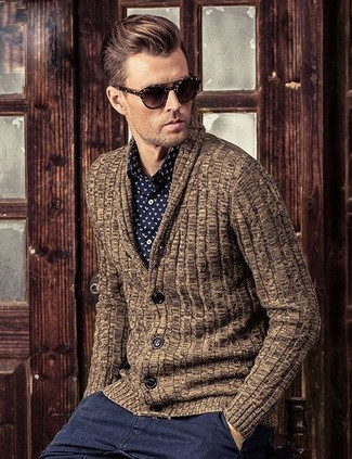How to wear: dark brown sunglasses, charcoal chinos, black and white print dress shirt, brown shawl cardigan
