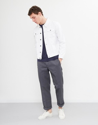 How to wear: white leather low top sneakers, charcoal chinos, navy crew-neck t-shirt, white denim jacket