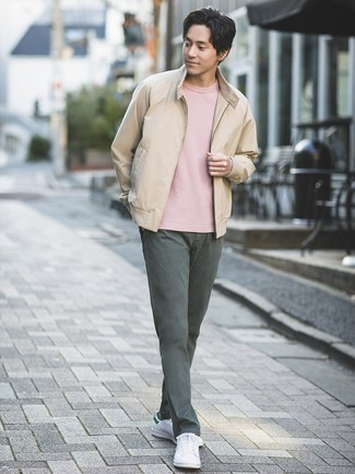 How to wear: white leather low top sneakers, charcoal chinos, pink crew-neck t-shirt, beige bomber jacket