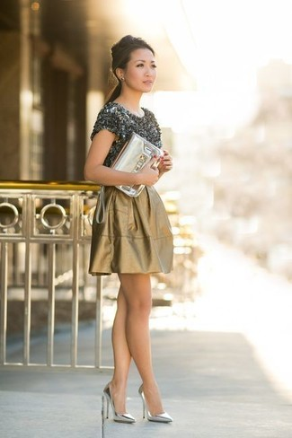 If you're all about being comfortable when it comes to fashion, this combination of a charcoal crew-neck t-shirt and a gold skater skirt is totally for you. Silver leather pumps will add elegance to an otherwise simple look. This combination will quickly become your warm weather go-to.