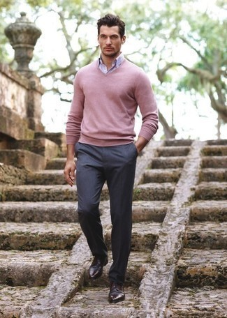 Men's Looks & Outfits: What To Wear In Spring: Wear a pink v-neck sweater with charcoal dress pants if you're going for a proper, dapper outfit. A pair of dark brown leather derby shoes is a smart pick to finish off your getup. Keep this look in mind come warmer weather, and we promise you'll save time getting ready on more than one morning.