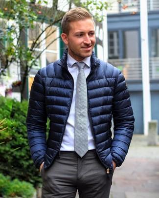 How to wear: grey polka dot tie, charcoal dress pants, white dress shirt, navy puffer jacket