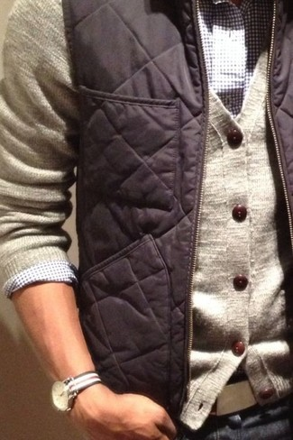 How to wear: charcoal gilet, beige cardigan, white and navy gingham long sleeve shirt, navy jeans