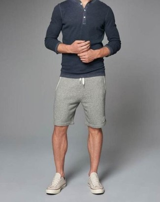 Stylish yet comfy, this look features an Eddie Bauer Signature Cotton Henley Sweater Dark Charcoal Heather Xxxl Regular Regular and grey shorts. Beige low top sneakers work wonderfully well within this look. Naturally, it's easier to work through a hot summer day in a fresh outfit like this.