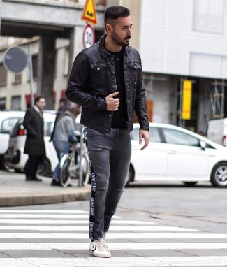 How to Wear Charcoal Ripped Jeans For Men: One of the best ways for a man to style a black leather shirt jacket is to team it with charcoal ripped jeans for a laid-back combo. Our favorite of a great number of ways to complete this ensemble is with a pair of white and black leather low top sneakers.