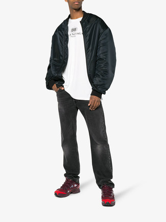 How to wear: burgundy athletic shoes, charcoal jeans, white print crew-neck t-shirt, black bomber jacket