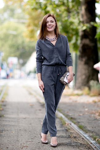 How to wear: charcoal jumpsuit, brown leather pumps, brown print leather clutch, brown necklace