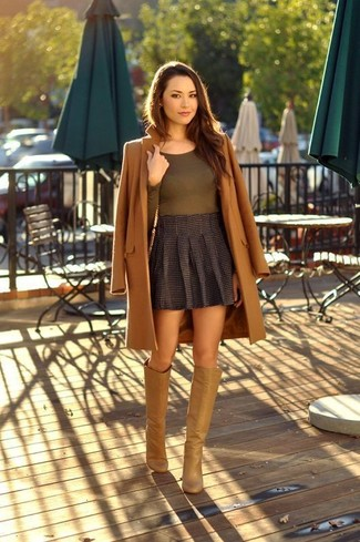 How to wear: tan leather knee high boots, charcoal pleated mini skirt, olive long sleeve t-shirt, brown coat