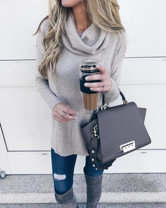 How to wear: black leather satchel bag, charcoal suede over the knee boots, navy ripped skinny jeans, grey cowl-neck sweater