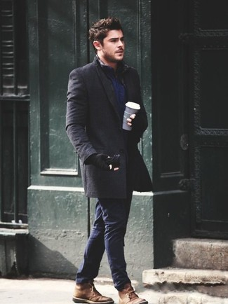 How to wear: charcoal overcoat, navy long sleeve shirt, navy chinos, brown suede desert boots