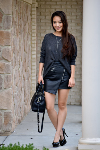 Team a charcoal knit oversized sweater with a black leather mini skirt for a casual coffee run. Black leather pumps will add elegance to an otherwise simple look.