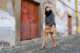 A dark grey knit oversized sweater and a tan skater skirt are a great outfit formula to have in your arsenal. Brown leopard suede pumps will add elegance to an otherwise simple look.
