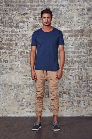 How to wear: charcoal plimsolls, tan sweatpants, navy crew-neck t-shirt
