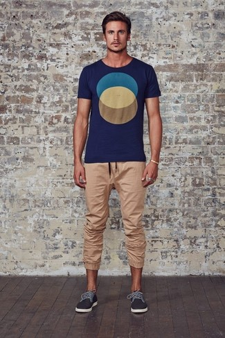 How to wear: charcoal plimsolls, tan sweatpants, navy geometric crew-neck t-shirt