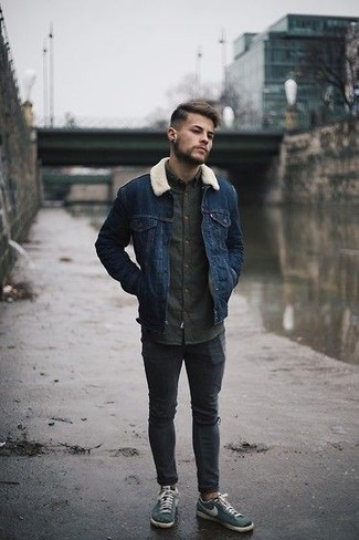 Men's Looks & Outfits: What To Wear In a Relaxed Way: Such items as a navy shearling jacket and charcoal ripped skinny jeans are the ideal way to introduce extra cool into your daily routine. Let your styling chops truly shine by complementing your ensemble with teal canvas low top sneakers.