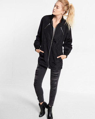 How to wear: black leather ankle boots, charcoal ripped skinny jeans, white and black horizontal striped v-neck t-shirt, black raincoat