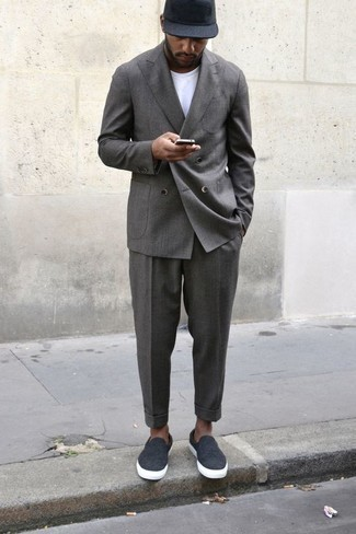 Men's Looks & Outfits: What To Wear In 2020: Step up your styling game by opting for a grey suit and a white crew-neck t-shirt. A pair of charcoal canvas slip-on sneakers immediately dials up the wow factor of this outfit.