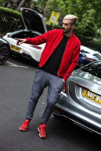 How to wear: red athletic shoes, charcoal sweatpants, black crew-neck t-shirt, red bomber jacket