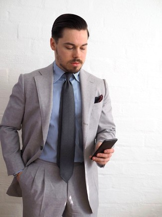How to wear: burgundy pocket square, charcoal tie, blue vertical striped dress shirt, grey suit