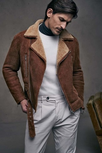 How to wear: grey chinos, charcoal turtleneck, white crew-neck sweater, brown shearling jacket