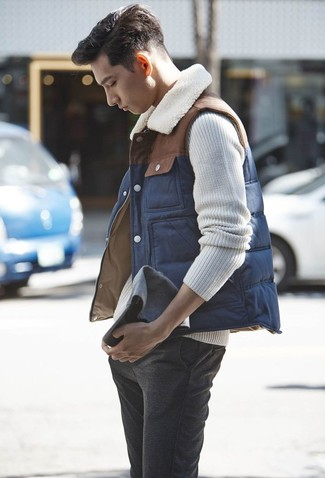 How to wear: charcoal wool chinos, beige cable sweater, navy gilet