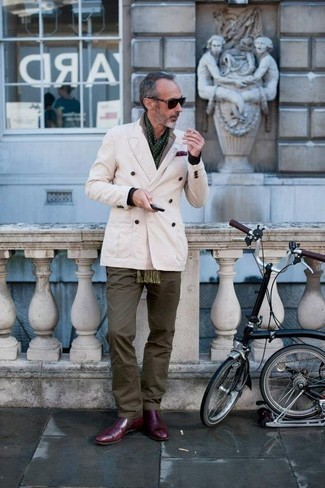 How to Wear a Beige Double Breasted Blazer For Men: Marrying a beige double breasted blazer with olive chinos is a wonderful option for a semi-casual getup. For maximum style points, add a pair of burgundy leather chelsea boots to the equation.