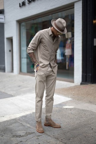 Men's Looks & Outfits: What To Wear In 2020: Consider wearing a beige long sleeve shirt and beige chinos to put together an everyday ensemble that's full of charisma and personality. Tan suede chelsea boots are a guaranteed way to infuse a dose of class into your ensemble.