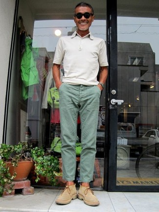 How to wear: black sunglasses, tan suede chelsea boots, mint chinos, white polo