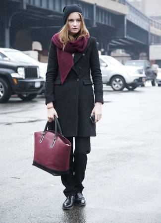 How to wear: burgundy leather tote bag, black leather chelsea boots, black dress pants, black coat