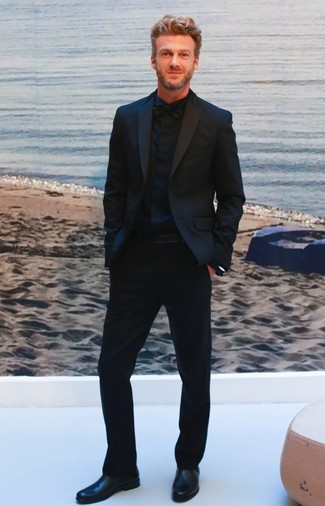 How to wear: black bow-tie, black leather chelsea boots, black dress shirt, black suit