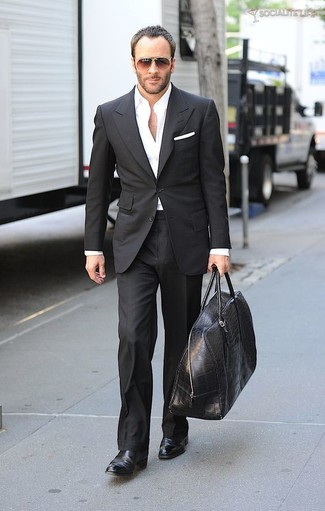 How to wear: black leather duffle bag, black leather chelsea boots, white dress shirt, black suit