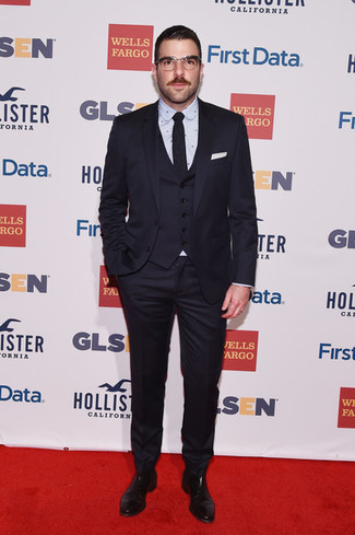 How to wear: black tie, black leather chelsea boots, light blue polka dot dress shirt, navy three piece suit