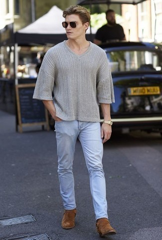 How to Wear a Grey V-neck Sweater For Men: Exhibit your credentials in menswear styling by wearing this off-duty combo of a grey v-neck sweater and light blue jeans. And if you wish to effortlesslly spruce up this getup with one single item, add a pair of brown suede chelsea boots to the mix.
