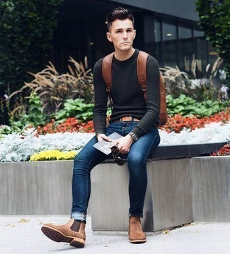 How to Wear a Charcoal Crew-neck Sweater For Men: You're looking at the indisputable proof that a charcoal crew-neck sweater and navy skinny jeans look awesome when you team them up in a casual look. Rev up this whole ensemble with a pair of brown suede chelsea boots.