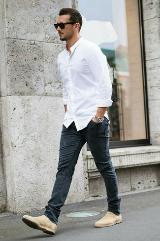 How to wear: black sunglasses, beige suede chelsea boots, charcoal skinny jeans, white dress shirt