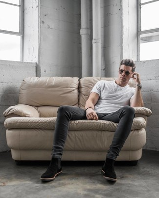 How to wear: dark brown sunglasses, black suede chelsea boots, charcoal skinny jeans, white henley shirt