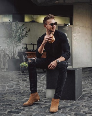 How to wear: black sunglasses, tobacco suede chelsea boots, black ripped skinny jeans, black long sleeve t-shirt