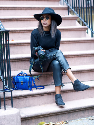 How to Wear a Blue Leather Crossbody Bag: If you're on the lookout for a relaxed casual yet seriously stylish ensemble, dress in a black sweatshirt and a blue leather crossbody bag. Black suede chelsea boots are an effortless way to add an added touch of class to your getup.