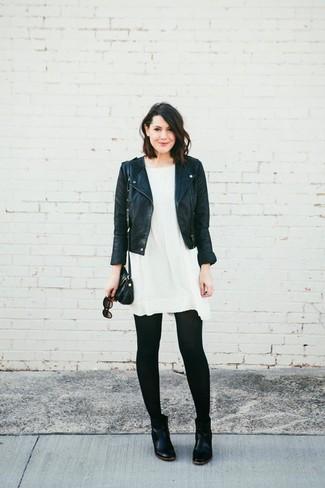 How to wear: black leather crossbody bag, black leather chelsea boots, white swing dress, black leather biker jacket