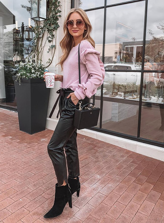 How to wear: black leather crossbody bag, black suede chelsea boots, black leather tapered pants, pink crew-neck sweater