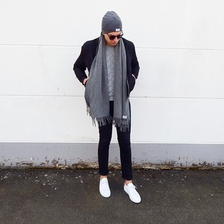 How to wear: white low top sneakers, navy chinos, grey cable sweater, navy wool bomber jacket