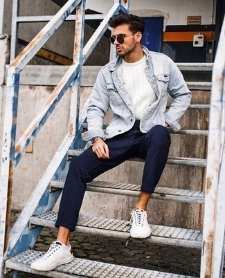 How to Wear White Canvas Low Top Sneakers For Men: Effortlessly blurring the line between sharp and off-duty, this pairing of a light blue denim jacket and navy vertical striped chinos will likely become your go-to. Round off with white canvas low top sneakers and the whole ensemble will come together.