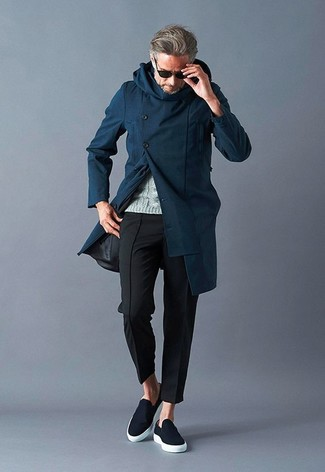 How to wear: black slip-on sneakers, black chinos, grey cable sweater, navy overcoat