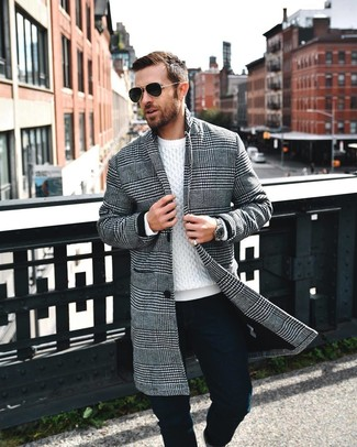 How to wear: black sunglasses, black chinos, white cable sweater, black and white houndstooth overcoat