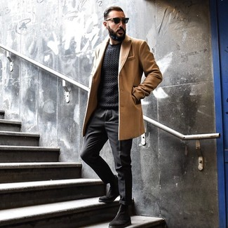 How to wear: black suede chelsea boots, black chinos, black cable sweater, camel overcoat