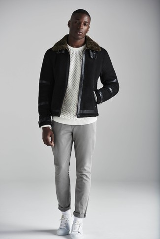 How to wear: white leather low top sneakers, grey chinos, white cable sweater, black shearling jacket