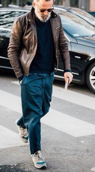 How to wear: beige suede athletic shoes, navy chinos, black crew-neck sweater, brown leather biker jacket